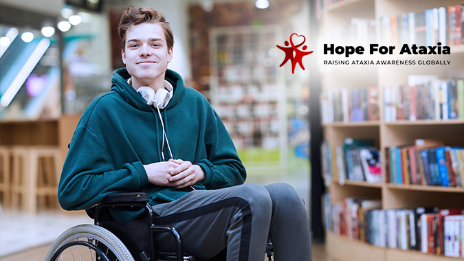 Young man with headphones sitting in wheelchair in modern library